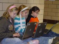 Elementary students enjoy learning on the go with wireless internet access. - click for larger image